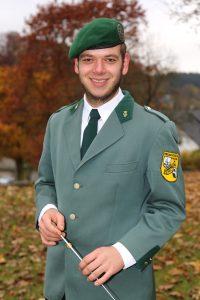 Dirigent D. Feldmann